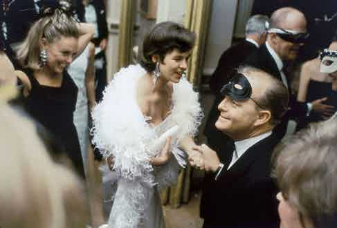 """Truman Capote at his """"Black and White Ball"""" at the Plaza Hotel, New York City, 1966. Photo by Elliott Erwitt courtesy of Magnum Photos."""