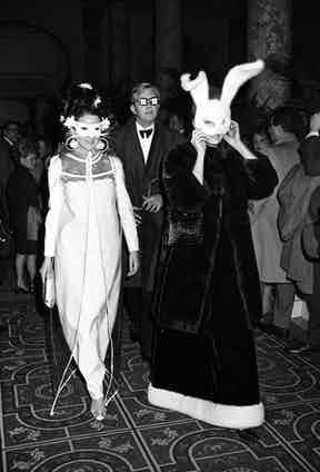 Candice Bergen (R, wearing rabbit ear mask) and another woman arriving at Truman Capote's Black and White Ball in the Grand Ballroom at the Plaza Hotell, 1966. Photo by Morrison Ray Scotty/Penske/REX/Shutterstock.