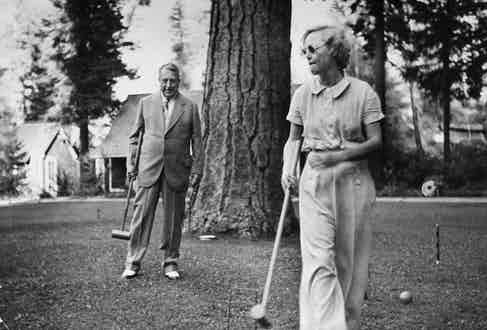 William Randolph Hearst Sr., and actress Marion Davies playing croquet on the grounds of his 50,000-acre estate, Wyntoon, 1935. Photo by Peter Stackpole/Life Magazine/The LIFE Picture Collection/Getty Images.