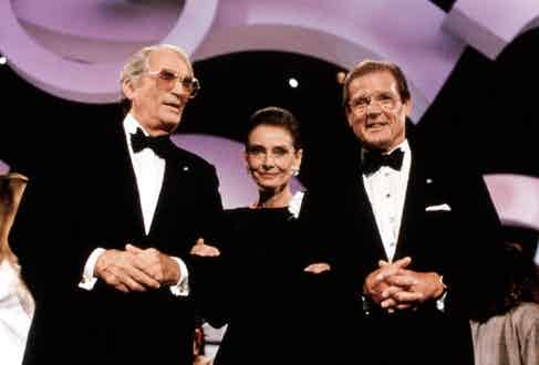 Gregort Peck, Audrey Hepburn and Roger Moore at the Danny Kaye International Children's Awards for Unicef. Photo by Everett/REX/Shutterstock.
