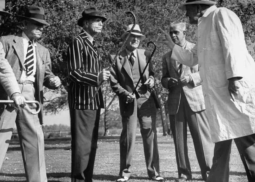 Actors Henry Stephenson, C. Aubrey Smith and Boris Karloff arguing with others during cricket game. Photo by Loomis Dean/The LIFE Picture Collection/Getty Images.