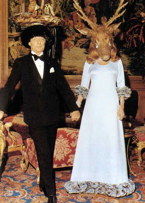 The baron and baroness holding court at their famous soirée, the 'Diner de Têtes Surrealistes', in 1972.