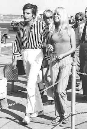 Brigitte Bardot and Gunter Sachs von Opel at Kennedy International Airport during their honeymoon, 1966. Photo by Everett/REX/Shutterstock.