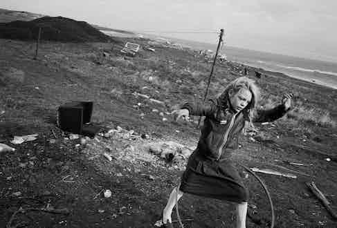 Helen and Her Hoola-Hoop, Seacoal Beach, Lynemouth, 1984, by Chris Killip.