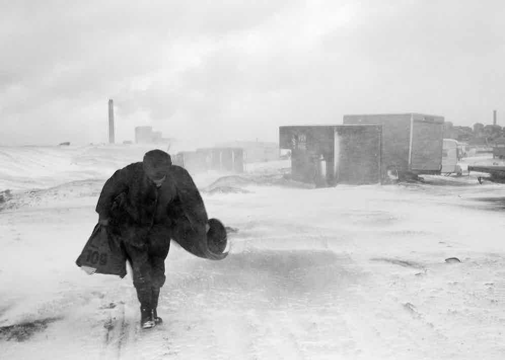 Cookie in the snow, Seacoal Camp, Lynemouth, Northumberland, 1984, by Chris Killip.