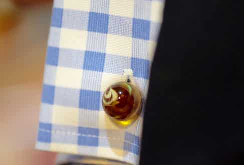 """These marbled glass cufflinks are an unusual design from Kilgour. Clive explains, """"I think they're Murano glass, I prefer cufflinks that are the same on both sides and which don't have a clasp to ruin the elegance of the look."""""""