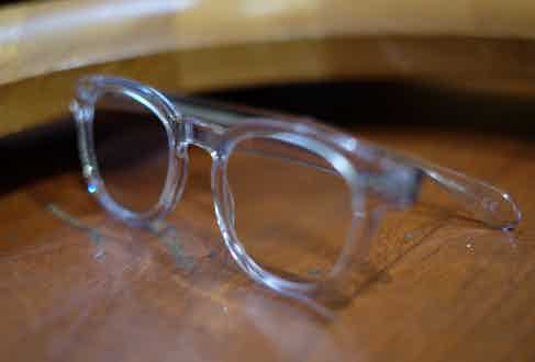 """David's Oliver Peoples' glasses are an unusual choice. """"I tend to wear tortoiseshell so I thought it would be interesting to try clear frames, as I'm quite grey and I like grey. I knew I wanted to keep wearing them as soon as I put them on."""""""