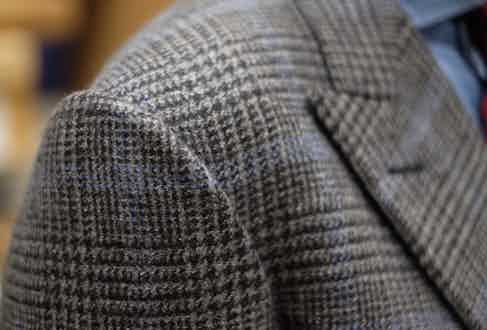 """Taking bespoke to the next level, the cloth of David's suit is the result of a collaboration with textile titan Johnstons of Elgin. """"I was like a little boy in a sweet shop. I went up to the factory and went through the archives, picking out elements that I liked – they designed a score of possibilities and also produced section blankets for me to choose from. Throughout, I'd wanted a Prince of Wales check, and this rather misty blue overcheck offered something a little unusual. It's half cashmere, half lambswool, and I wear it everywhere."""""""