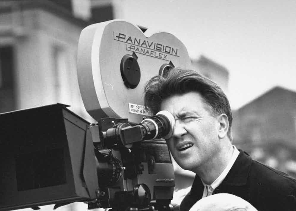 David Lynch, looking through Panavision Panaflex movie camera as he directs filming of Wild at Heart on street location. Photo by Acey Harper/The LIFE Images Collection/Getty Images.