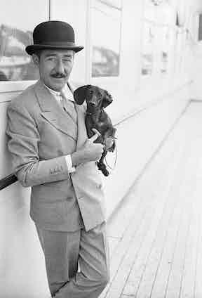 Holding a Dachshund aboard a ship, 1932