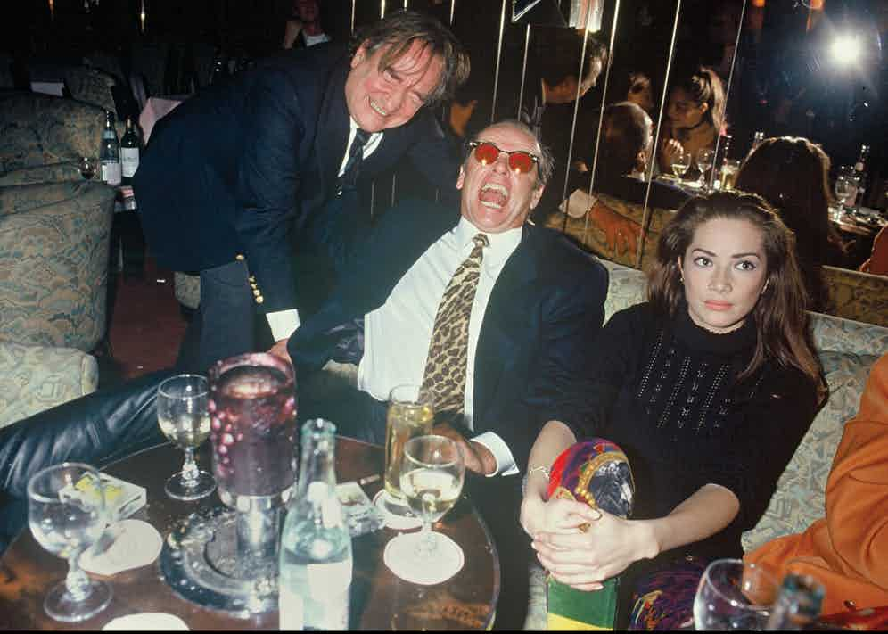 Photographer Willie Rizzo with a howling Jack Nicholson at Régine's in 1993.