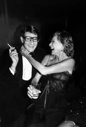 Designer Yves Saint Laurent with socialite Nan Kempner during party for the launching his new perfume called Opium, held aboard the sailboat Peking at the South Street Seaport Museum. Photo by Robin Platzer/The LIFE Images Collection/Getty Images.