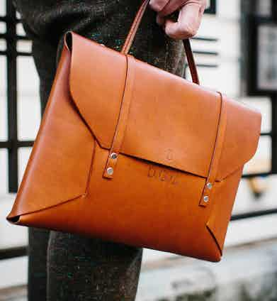 """Dean's bag is a reinterpretation of his school music bag from when he was a child – which his friend, ex-colleague and craftsman Jade Rhone made for him. """"I kept the bar from the original bag so it's a bit rusty, and it's just one piece of leather that folds into itself and which has my initials and my friend's logo."""" He keeps his iPad, and other necessities in it and he adds, """"I need one to go with every outfit!"""""""