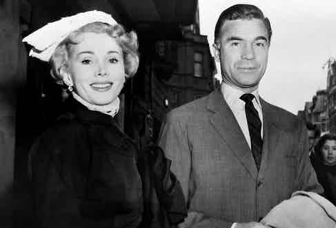 US actress Zsa Zsa Gabor and her companion, Porfirio Rubirosa, poses in Paris, on May 4, 1954.  Photo by AFP/Getty Images.