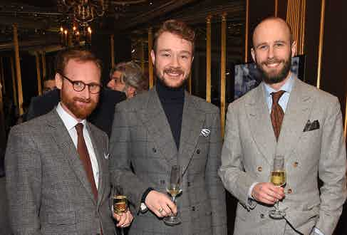 Jerome Mackay, Aleks Cvetkovic and Simon Crompton at The Rake's 50th issue party at Hotel Café Royal on February 10, 2017 in London, England.