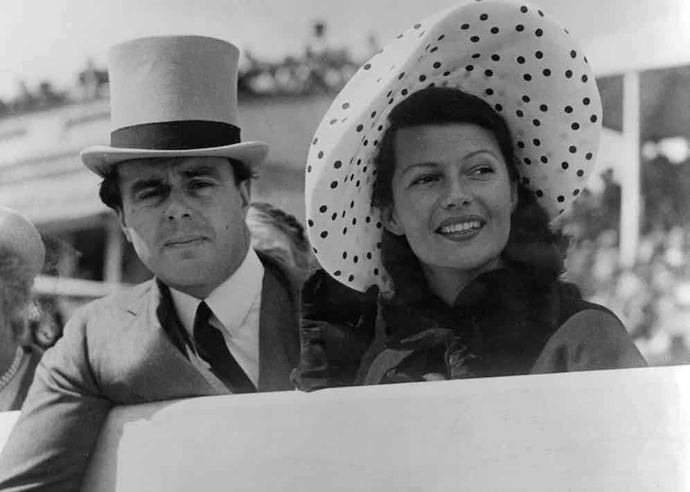 Prince Aly Khan at Epsom races with his wife, Hollywood actress Rita Hayworth. Photo by George W Hales/Getty Images.