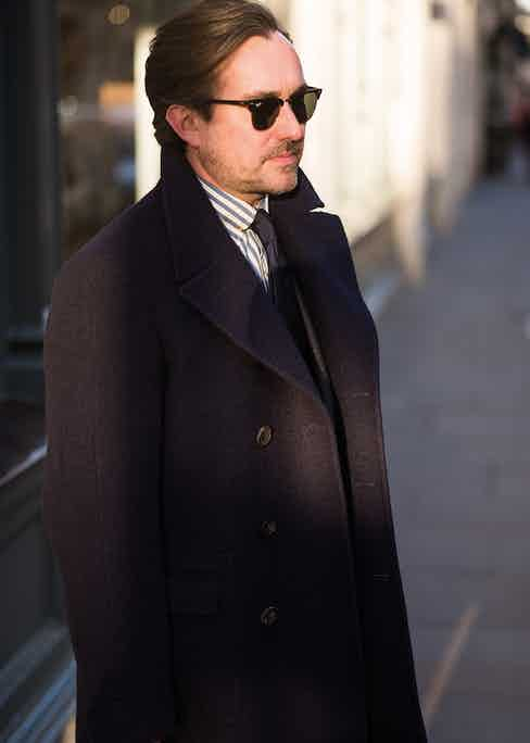 """Chris's Casentino coat is a Chester Barrie creation, naturally: """"Although it's a typical Florentine cloth, I styled it as a British greatcoat. The Italians are good at taking English cloths and cutting them in their local manner, so I've returned the compliment."""""""