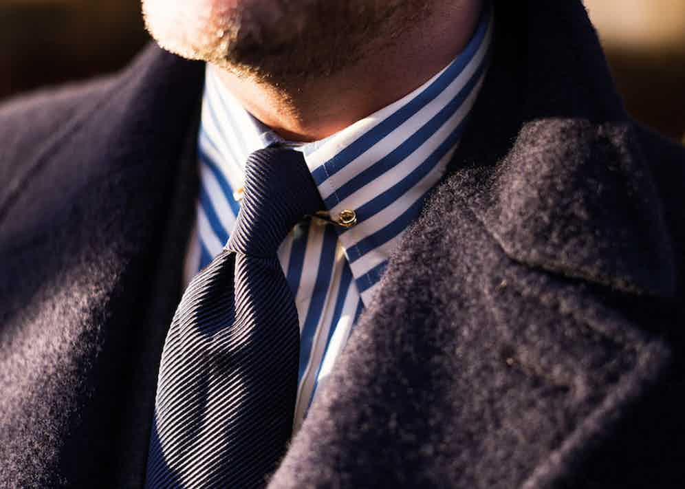 """Modoo's collar pin is a gold-plated clip-on creation unique to Chester Barrie. """"I've worn a pin-collar since the 1980s,"""" he explains. """"I like the way it lifts a tie knot. The fullness of the look complements the chest of a Chester Barrie suit."""""""