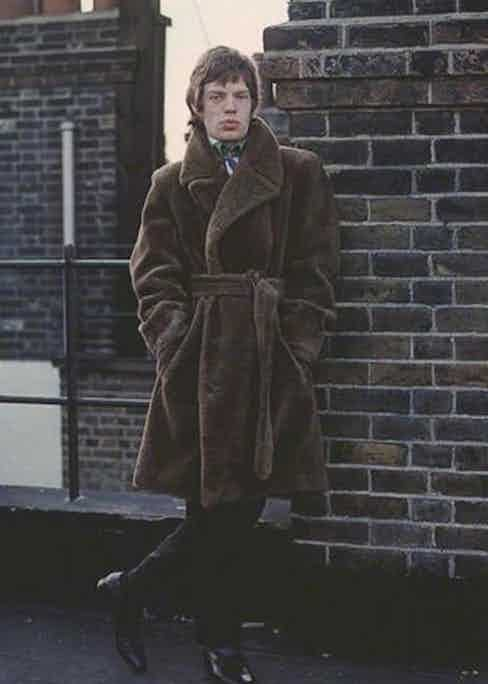 Mick Jagger wears a chocolate brown teddy bear coat.