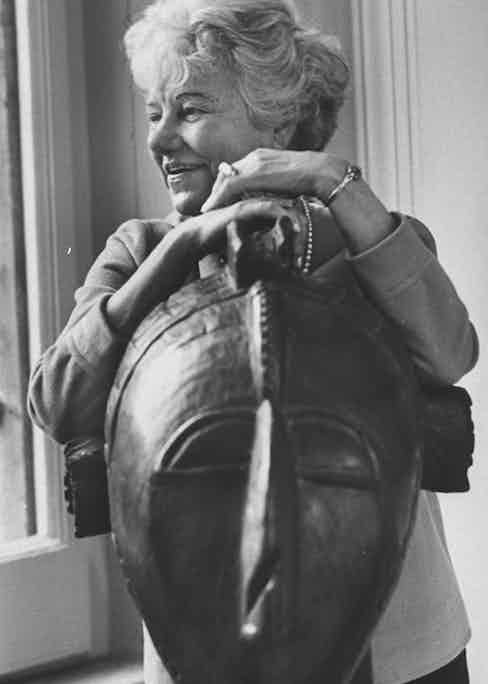 Peggy Guggenheim with Guinean native mask at her palazzo-gallery. Photo by Carlo Bavagnoli/The LIFE Picture Collection/Getty Images.