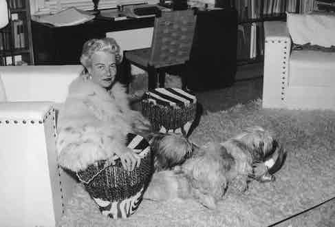 Peggy Guggenheim at her home in Venice with her dogs , December 1961. Photo by Keystone Features/Hulton Archive/Getty Images.