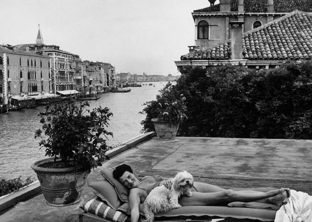Peggy Guggenheim on the roof top of her Venice home. Photo by Frank Scherschel/The LIFE Picture Collection/Getty Images.