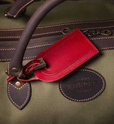 Ettinger's red luggage tag.