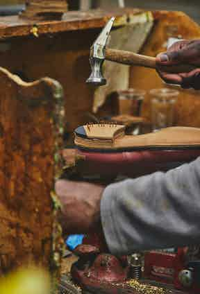 The heel is applied to the shoe using nails. Photo by James Munro.
