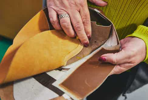 July Smart showcases the extra layer of skin used to reinforce the side of the shoe. Photo by James Munro.