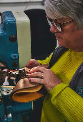 July Smart applying the fine details to a brogue using traditional machines. Photo by James Munro.
