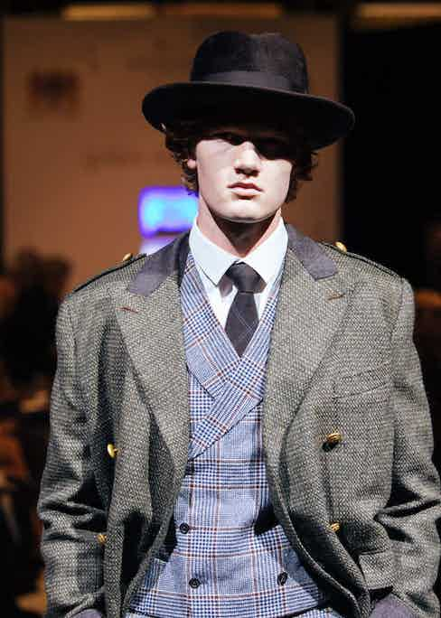 Double breasted olive green tweed coat with waistcoat and trouser in Prince of Wales Check by Donghyun Kim, student at LCF.