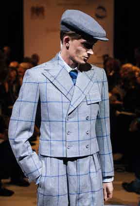 Smoke grey golf jacket with plus fours by Alexander Hills, apprentice at Dege & Skinner.