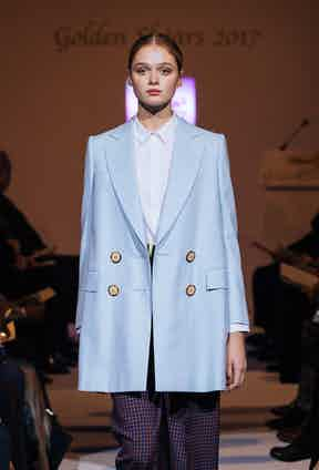 Double breasted baby blue coat by Rachel Singer, student at Savile Row Academy.