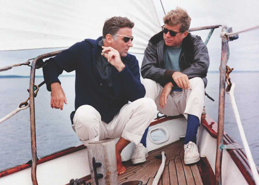 President Kennedy and his brother-in-law Peter Lawford aboard the United States Coast Guard yacht 'Manitou', 1962. Image © CORBIS/Getty.