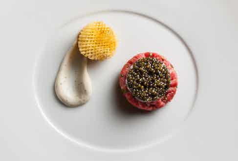 Raw Wagyu Beef, Langoustines and Osetra Caviar with Black Pepper-Vodka Crème Fraîche and Pomme Gaufretteprepared by Eric Ripert, Chef of Le Bernardin in NYC.