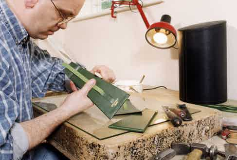 An artisan working in Ettinger's factory in Walsall.