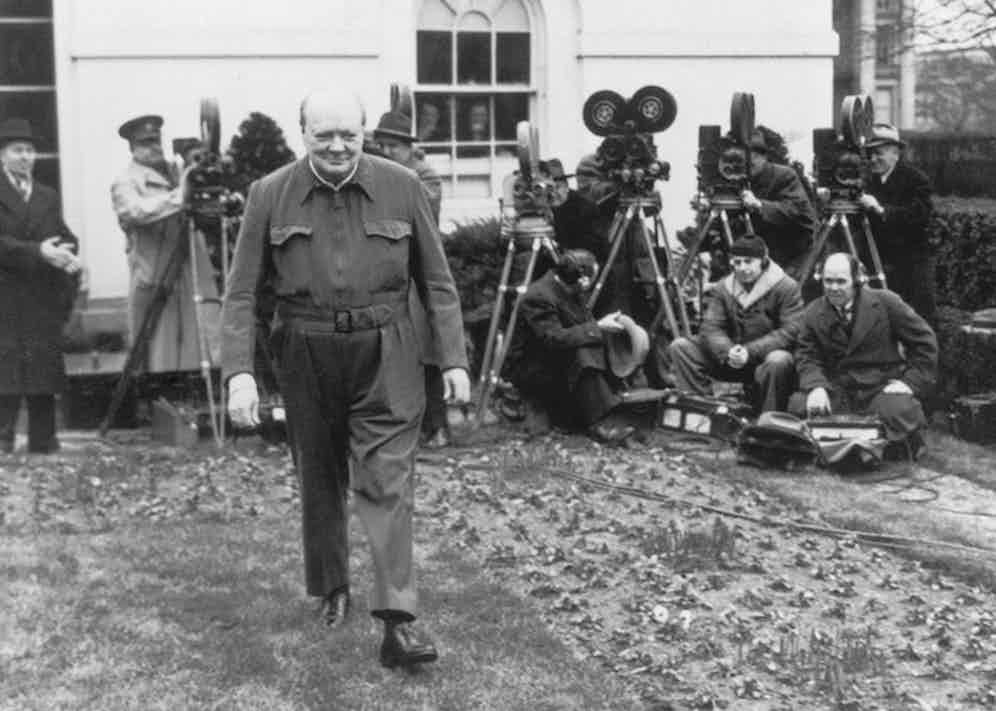 British Prime Minister Winston Churchill poses for the cameras in the grounds of the White House, wearing his 'siren suit', a one-piece garment which can be donned in a minute, 17th January 1942. Photo by Hulton Archive/Getty Images.