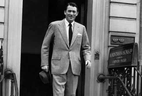 Gregory Peck wearing Huntsman outside their Savile Row atelier.