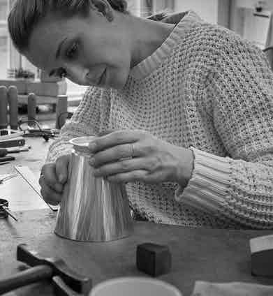 A piece from the Georg Jensen Bernadotte cocktail set being hand crafted.
