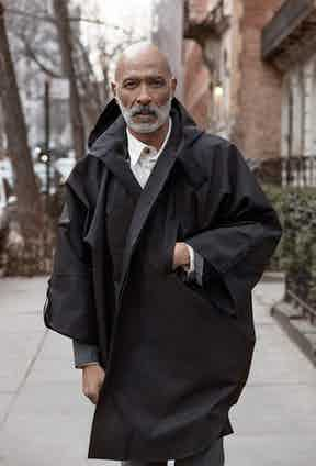 Black eco polyester and viscose Raincho coat, Norwegian Rain; ecru cotton safari shirt, Private White V.C.