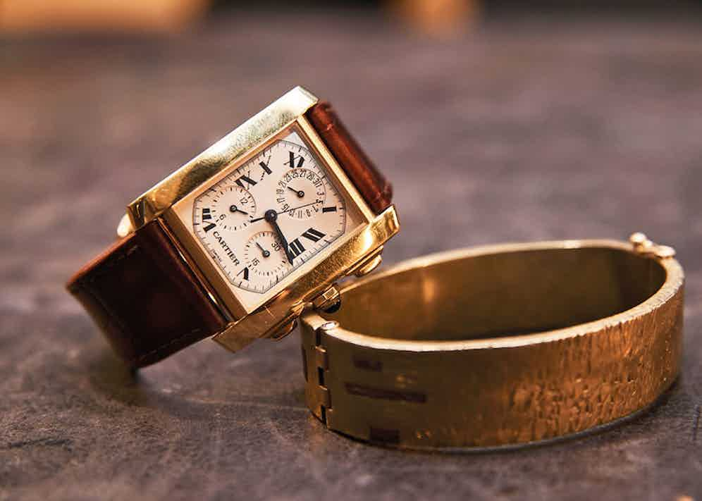 Vintage wrist game from Simon. The watch is a Cartier Chronoflex with a Jean Rousseau watch strap patinated by Gaziano & Girling. The brass bracelet is designed by Simon but was made by the independent bespoke jewellery designer Diana Maynard.