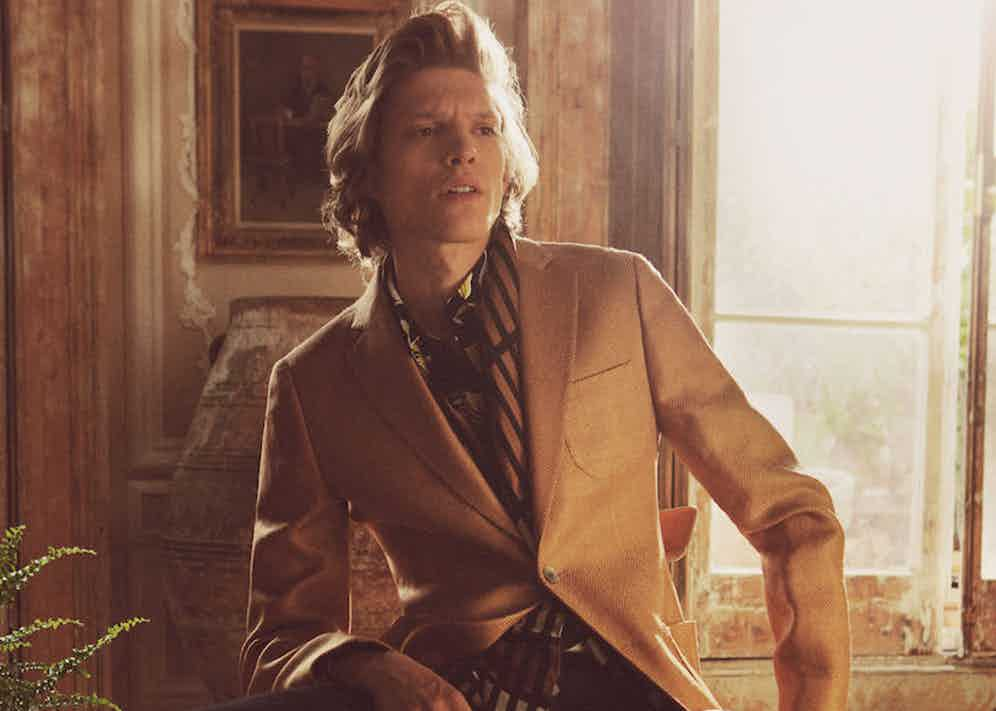 Gold silk and wool blazer and brown patterned scarf, both Hardy Amies; floral print cotton shirt, Marni; navy cotton and silk trousers, Bally; sunglasses, Ray-Ban; loafers, Mr. Hare. Photo by Kalle Gustaffson for Issue 45.