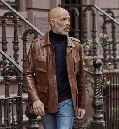 Chocolate brown lambskin leather Hoffman jacket, Cromford Leather Co.; black and navy wool, cable-knit roll neck jumper, Vilebrequin; blue denim jeans, 7 for all Mankind.