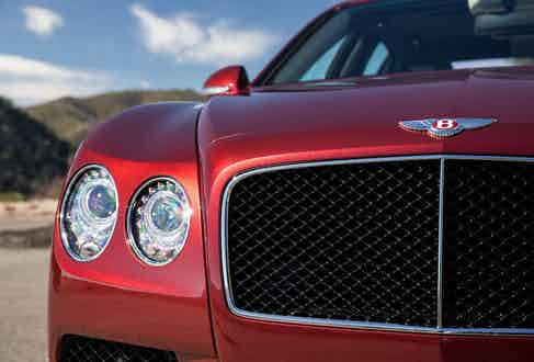 The rounded headlights, 'B' Bentley badge and aggressively wide grill are all synonymous with Bentley.