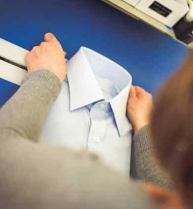 An Emma Willis shirt on the folding table.