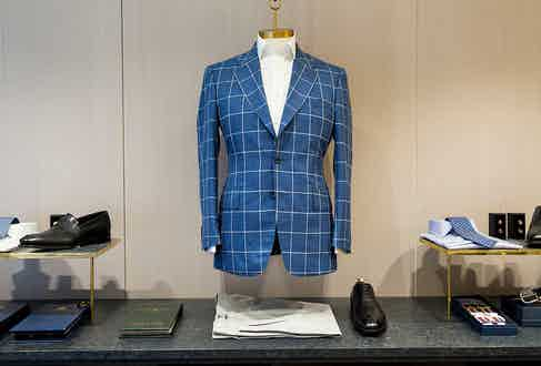 A windowpane check single-breasted jacket by English Cut.