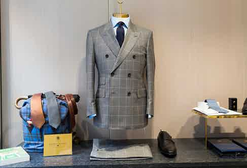 A grey and white double breasted jacket at English Cut's store.
