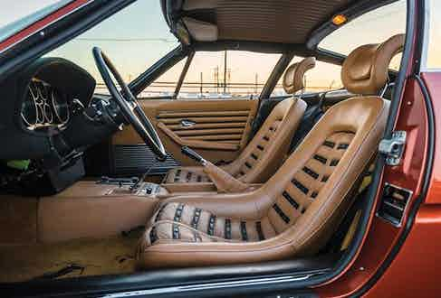 The Nero seat inserts contrast beautifully against the beige leather interior.