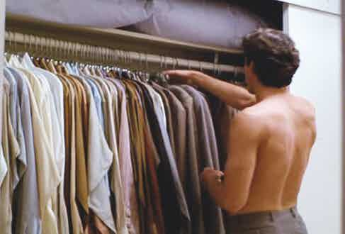 Julian played by Richard Gere, chooses a shirt from his wardrobe in American Gigolo, 1980.