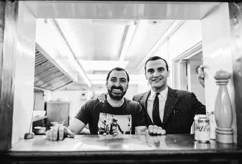 """Nevio Pellicci, third generation owner of the café. On arrival at Pellicci's he joked with James, """"you don't have time for us now you've got a film crew with you!"""""""